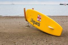 English lifeguard yellow board on beach Royalty Free Stock Photos