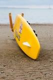 English lifeguard yellow board on beach Stock Image