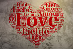 English: Love. Heart shaped word cloud Love, grunge background. Focus on English: Love. Word cloud in heart shape on Grunge Background. saying thanks in multiple Stock Photos