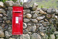 English Mailbox. Posted on an old dry stone wall, Wast Water, English Lake District, UK Royalty Free Stock Image