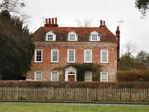 English Manor House. English Georgian Manor House with Picket Fence and Beech hedge to the front Stock Photos