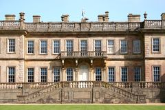 English Manor House. English country manor house on clear, sunny day royalty free stock photo