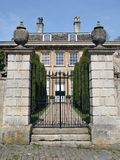 English Mansion. Gate and Garden of an English Mansion Royalty Free Stock Photography