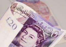 English money. Twenty pound notes close up