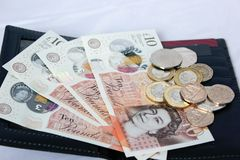 English money and coins in leather wallet stock photo