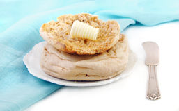 English Muffin and Butter with Knife Stock Images