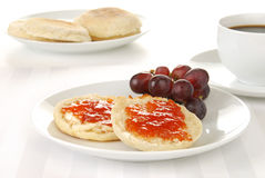 English muffin and coffee. A toasted english muffin with black coffee royalty free stock photo