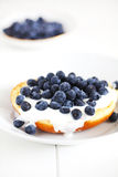 English muffin with cream and blueberries, breakfast Stock Images