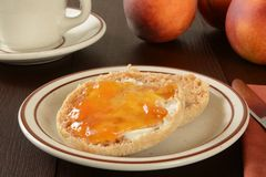 English muffin with peach jam Stock Photos