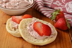 English muffin with strawberry cream cheese Stock Images