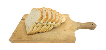 English muffin toasting bread slices on a cutting board Royalty Free Stock Images