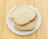 English muffin toasting bread slices on a plate Royalty Free Stock Images
