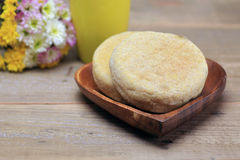 English muffin on the wooden plate Stock Photos