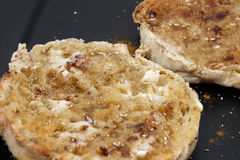English Muffins. Toasted breakfast english muffins with butter, cinnamon and honey Royalty Free Stock Image