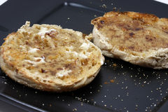 English Muffins. Close-up of toasted english muffins with butter, honey and cinnamon Royalty Free Stock Photos