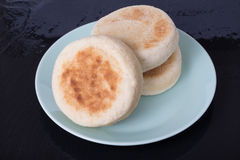 English Muffins. On a Blue Plate Stock Image