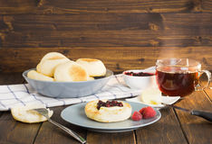 English muffins with jam and butter Royalty Free Stock Photography