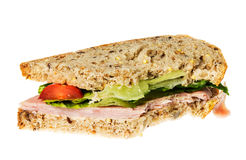 English multigrain bread ham sandwich with bite Royalty Free Stock Images