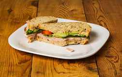 English multigrain bread ham sandwich with bite Royalty Free Stock Photography