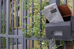 English newspaper in steel mailbox in angle view Royalty Free Stock Photos