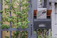English newspaper in steel mailbox in front view Royalty Free Stock Photos