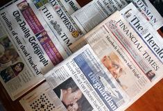 English newspapers. Front pages on a table - Financial Times, The Herald, The Guardian, The Daily Telegraph and The Times Royalty Free Stock Images