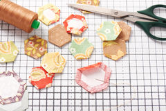English paper pieced hexagons on white craft mat Stock Photography