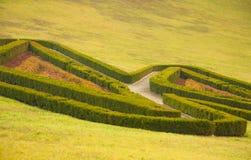 English park. Labyrinth in autumn scene Stock Photos