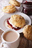 English pastries: scones with jam and tea with milk close-up. ve Royalty Free Stock Image