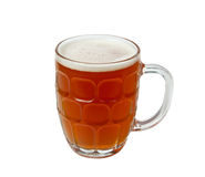 English Pint of golden ale. Golden brown beer in an English style pint mug with foamy head stock photography