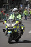 English policeman on motorbike Stock Images