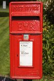 English Post Box. Royal Mail Post box in English country village Royalty Free Stock Images