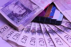 Money to spend 1000 pounds lying on a table income travel. English pounds money cash payments pay earn currency 20pounds income tourism scads roll needfull bank Royalty Free Stock Photos