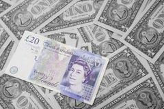 English pounds on usa money background. Royalty Free Stock Image