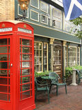 English Pub. With exterior red telephone booth Stock Images