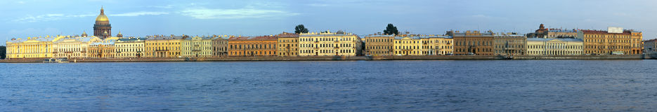 English Quay in St. Petersburg. Panorama of English Quay with historical houses and Isaakievsky cathedral in St. Petersburg, Russia, view from another side of Stock Photo