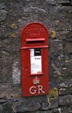 English red letter box. Letters only mail box, red with gold lettering GR and the Royal crown royalty free stock image