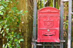 English red mailbox hang on gate. Traditional English red mailbox hang on gate Royalty Free Stock Photography