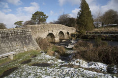 English river with old stone bridge on Dartmoor England UK. The East Dart River and old road bridge built in the 1700`s at Postbridge on Dartmoor in Devon stock photos