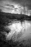English river in winter black and white Royalty Free Stock Images