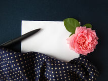 English rose and blank card for text on  fabric Stock Photo