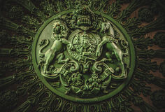 English Royal Coat of Arms at Wellington Arch. Ornate full frame close-up of heraldic coat of arms of United Kingdom with lion and unicorn.This artwork is found Stock Photo