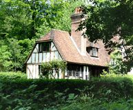 English Rural Cottage. Timber Framed English Cottage in a Woodland setting Royalty Free Stock Image
