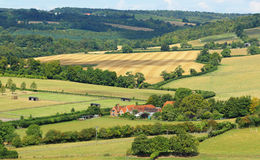 An English Rural Hamlet in Oxfordshire. English Landscape in the Chiltern Hills of Buckinghamshire with Farmhouse in the valley Royalty Free Stock Photography