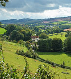 An English Rural Hamlet in Somerset, UK. An English Landscape in Somerset with Hamlet in the Valley royalty free stock images