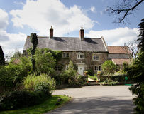 English Rural House. Natural Stone Rural English House and garden Royalty Free Stock Image