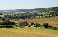 English Rural Landscape. With a Farmhouse and Sheep grazing in a Field Royalty Free Stock Images