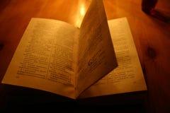 English-Russian dictionary. Evening, candles, dictionary, camera stock photo