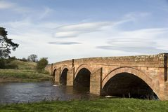 English sandstone arched bridge. Stock Photos