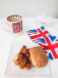 English sausage sandwich with, brown sauce, cup of tea and flag Royalty Free Stock Images